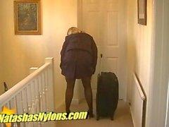 flight attendant in uniform and sheer black pantyhose and spike high heel stilettos