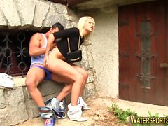 Whore rides pissing cock
