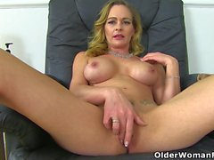 British milf Kitty Cream strips off and plays