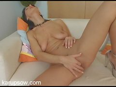 Milf in sexy silver high heels plays with her cunt