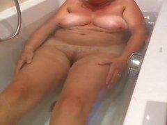 hidden cam unaware MILF in the bath