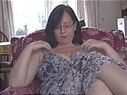 Busty mature milf in pantyhose talks dirty as she strips, teases and toys