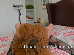 Curly-haired mature Leona Gets Frisky on the Bed