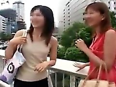 Two beautiful Asian ladies drop their clothes and flaunt th
