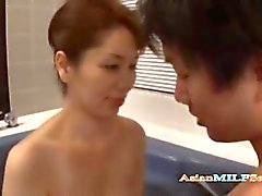 Busty milf sucking a guys cock in the hot tub