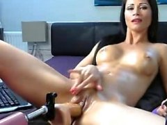 attractive MILF playing with her toys on cam