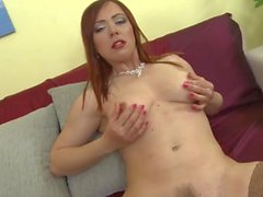 Sultry redhead tweaks her milf nipples erotically