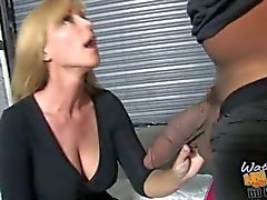 Black dude fucks a blonde milf as her son watches