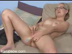 Nerdy glasses are hot on the masturbating blonde milf