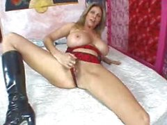 Milf in boots has huge tits and loves cock