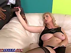 Stockings clad blonde milf sucking a black cock