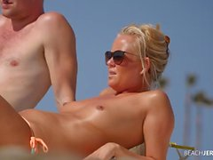 Topless milf works on her tan and gets spied on