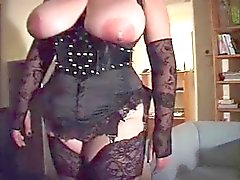 Slave with big tits in black corset and Nylon Stockings