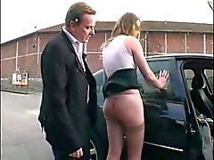 He humiliates his wife in the street and pegs her tits