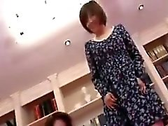 Two enchanting Oriental milfs put their lips to work on a l