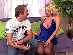 Blond cougar with big tits in stockings fucks great 2