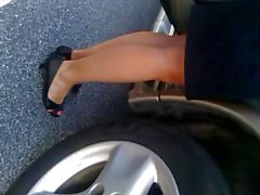 MILF upskirted in a parking lot