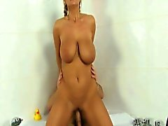 Blonde milf with mega tits plugged in the bathroom