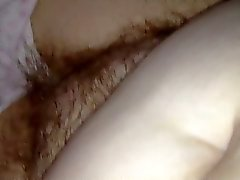pulling on the wifes hairy pussy under the sheets
