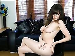Busty Brit With A Bush Does A Striptease