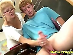 Amateur mature teacher jerking students dick
