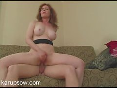 Redheaded mom hottie climbs on top and rides his dick
