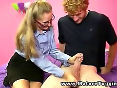 Mature handjob milf in glasses tugging