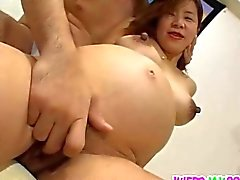 Pregnant Asian chick is fucked by two guys