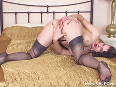 Cute Milf masturbates to orgasm in sheer nylons garters