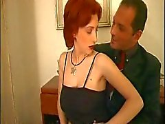 Sweet redhead in stockings takes two dicks
