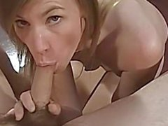 Milf wraps her lips round hard cock