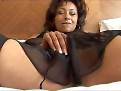 Busty mature Danica masturbating in stockings