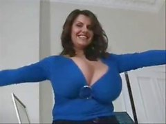 Busty, chubby brunette trying on clothes and showing her huge boobs